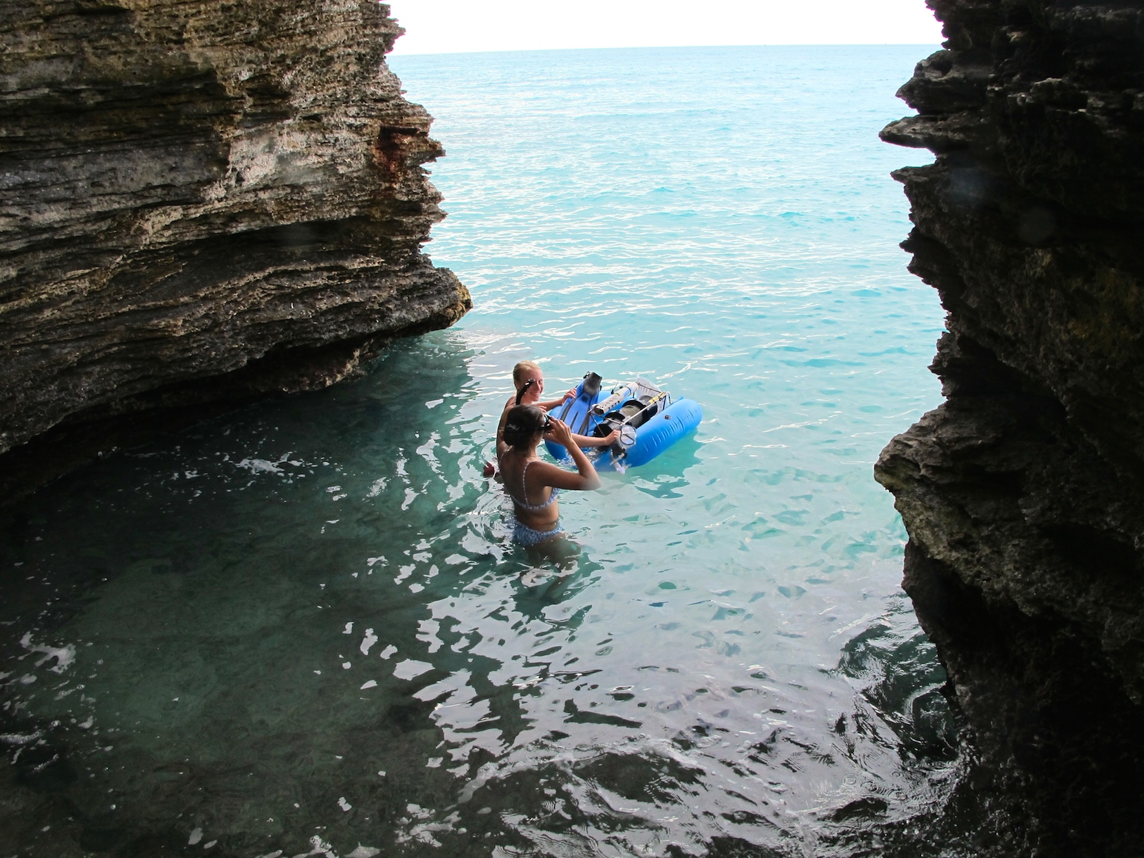 student with swim mechanic in the ocean