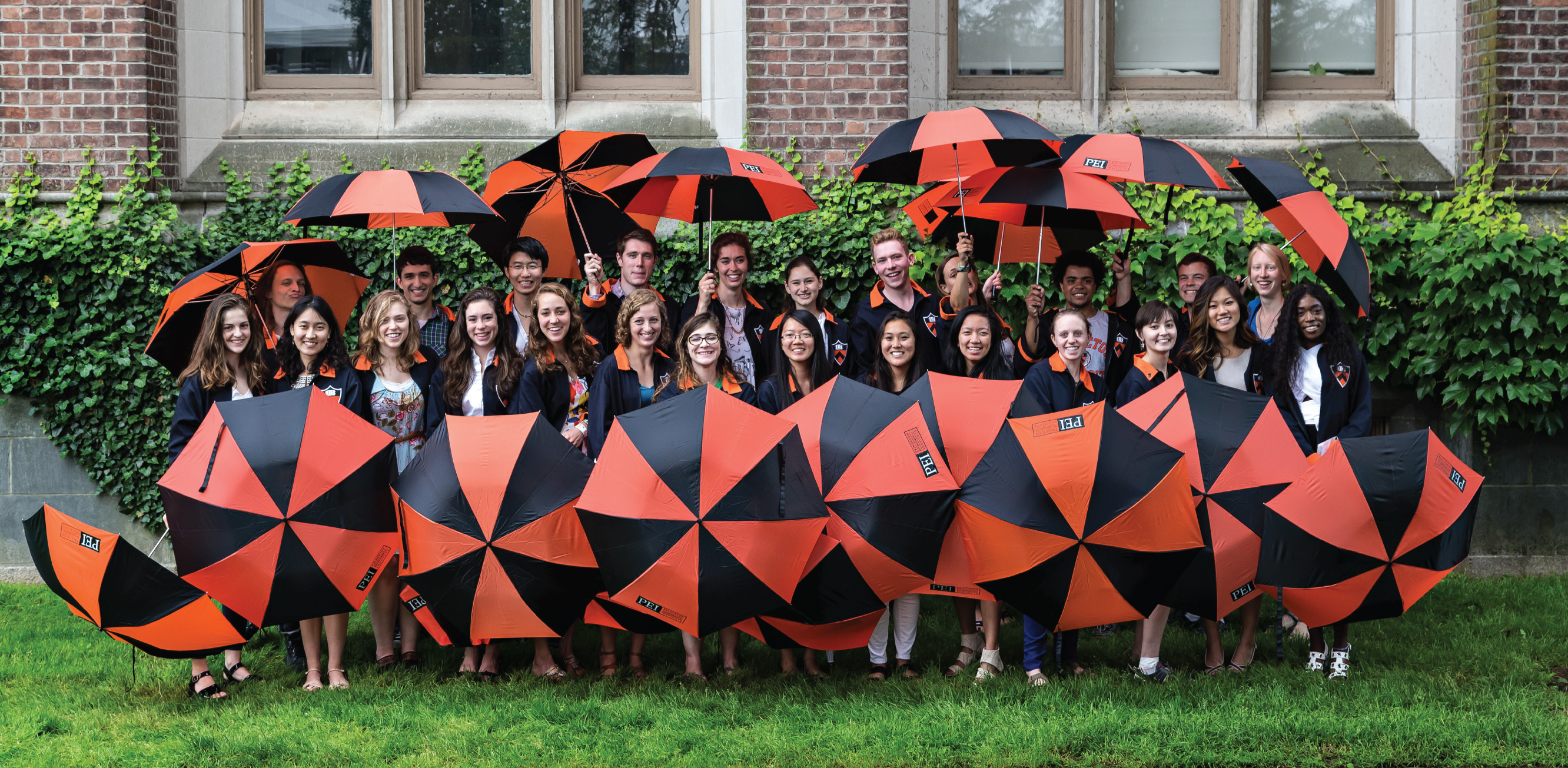 Class Day students posing with umbrellas