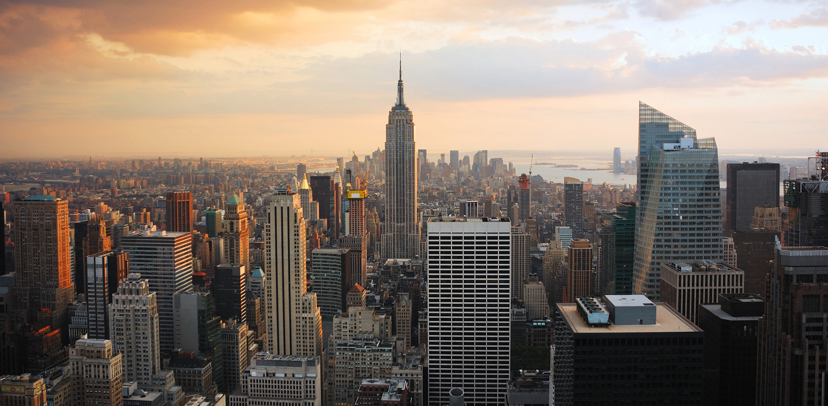 The Empire State building surrounded by other tall buildings