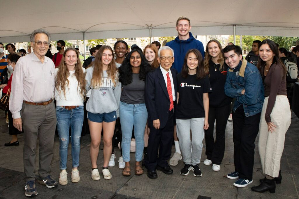 Syukuro Manabe poses with students and Robert Socolow