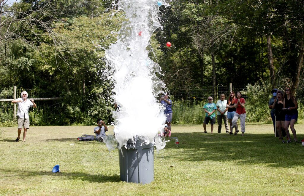 Liquid exploding upward from a trash can.